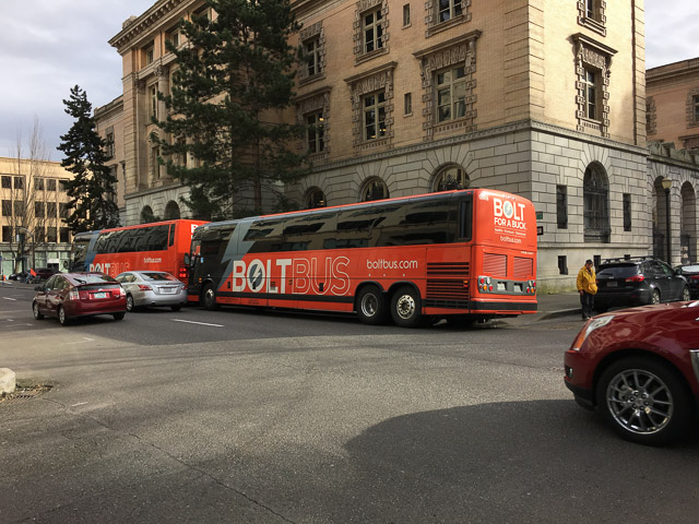 Idling Bolt buses block street crossing